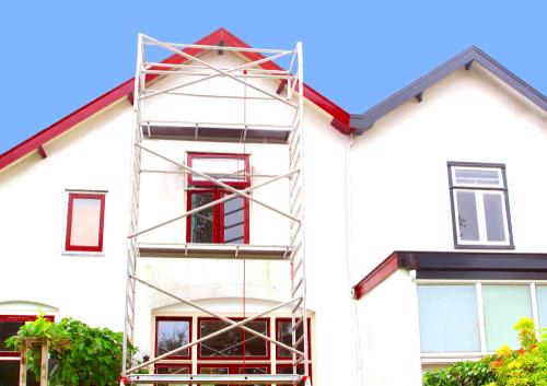 Utomhusmålning på ett hus i Helsingborg